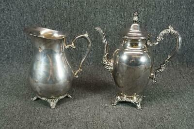 W. M. Rogers Silver Plated Set Of Two Pitchers One With Lid