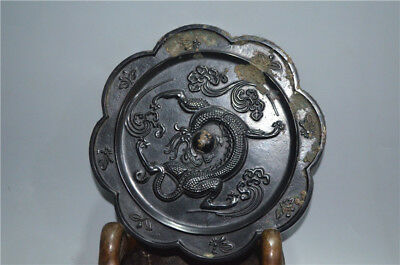 antique  Ancient China figure in the shape of a dragon bronze mirror.