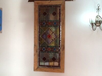 antique multi coloured stained glass in elm frame