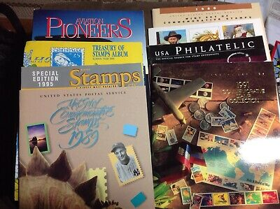 Assortment of philatelic books. stamp collecting. Albums. Cards. USPS. Aviation