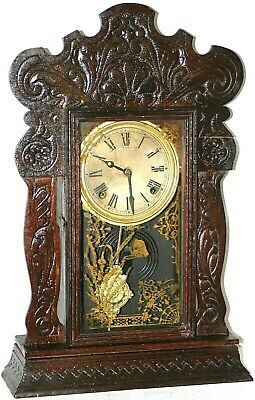 Antique Sessions Pressed Oak Gingerbread Mantel Clock In Deep Walnut Finish.