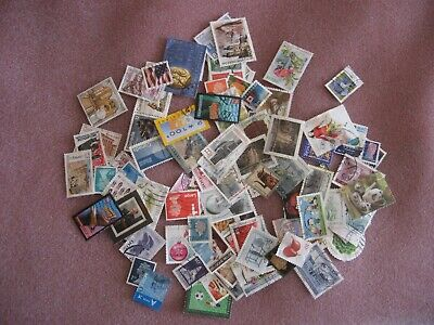 100 mixed world stamps.No repeats.Paper backs off. Canada,Hungary,USA etc.Used