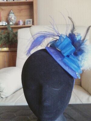 Fascinator - blue sinamay with flower, feathers  on sinamay base on a h/band