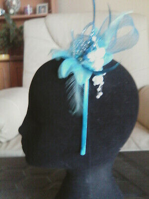 Fascinator - blue sinamay  with feathers & beads on  on a headband