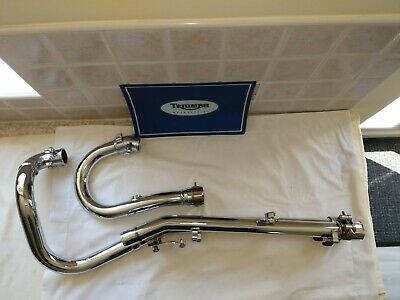 Triumph scrambler exhaust down pipes headers header removed from a new machine
