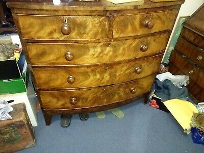 bow-front mahogany chest of drawers
