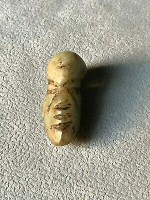 Precolumbian face bead carved stone