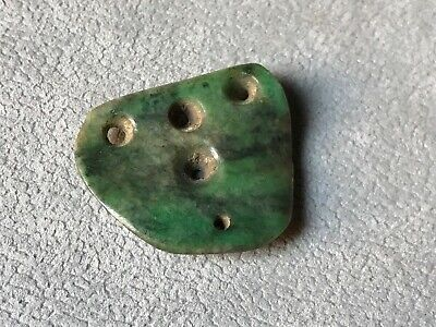 Precolumbian big bead carved top green stone.