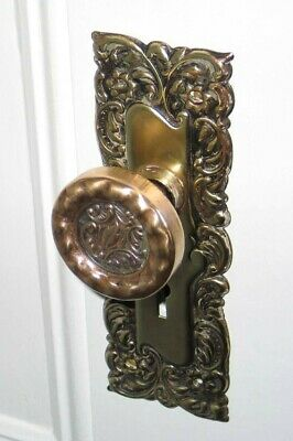 Antique brass door knobs with back plate escutcheons (5 sets)
