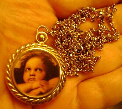 Locket Pendant/Necklace with watch inside includes nice long chain works great