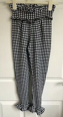 Ladies/Girls Black/White PrettyLittleThing Checked Frill Trousers - Size 4 BNWT