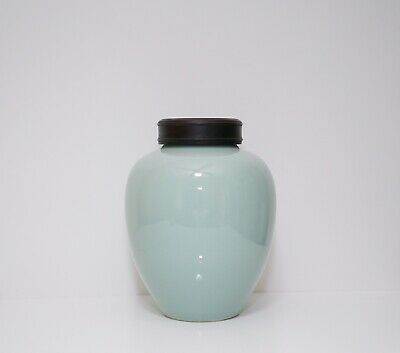 A Celadon Glazed Jar with a Wooden Cover