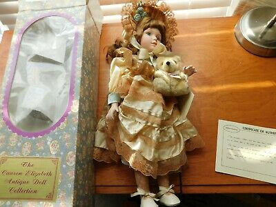 "This is a 17"" porcelain doll with a music box that plays Thank goodness for litt"