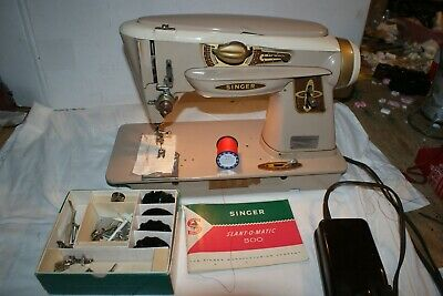 Singer model 500, The ROCKETEER sewing machine with book, attachments.
