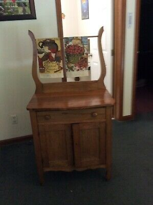 Wash Stand, light brown, 2 doors with drawer and towel rack. Good condition