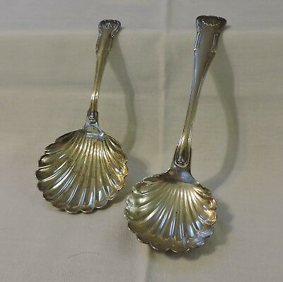 A PAIR OF S. KIRK & SON SUGAR SHELL SPOONS-one sterling, one coin silver