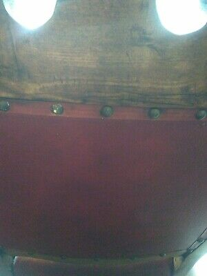 Two antique red leather chairs in good condition