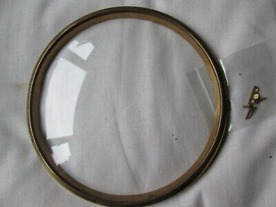 A Smiths Enfield Brass Mantel Clock Bezel And Convex Glass  With Its Case Catch