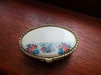 Small Metal Oval Pill Box with lovely floral design on the lid 5x1.5 cms in size