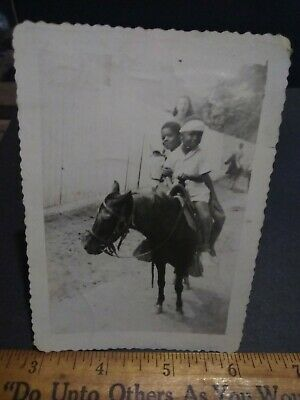 Rare Segregation African American kids riding a pony with a white lady