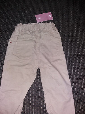 Girls Stone colour trousers. New with tags Age1-1½ years adjustable waist