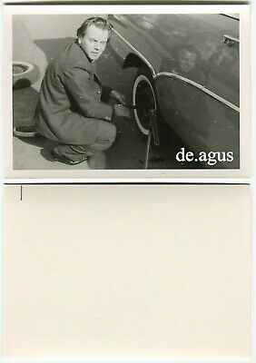 Vintage Photo circa 1960s young man in suit changing a Car Wheel