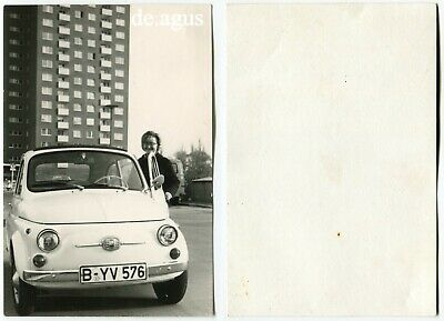 Vintage Photo circa 1970s happy young Woman,Fiat 500