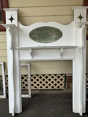 timber freplace mantle with beveled mirror