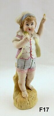 Antique German Bisque Porcelain Young Male Figurine in Shorts Holding Bread F17