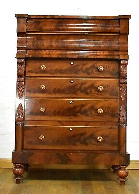 Antique large carved Victorian flame mahogany Scotch chest of drawers