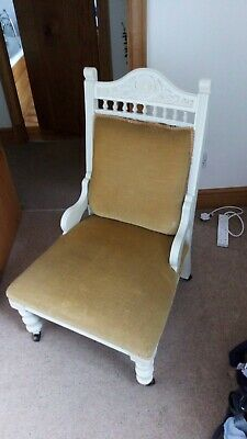 Antique Victorian Nursing Chair. Gold velvet covering with painted mahogany wood