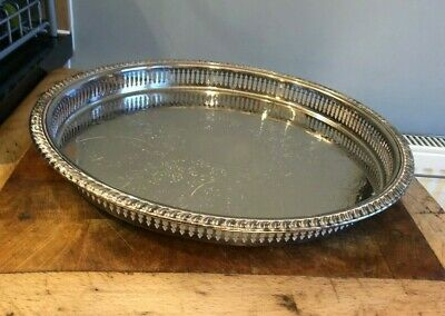 Large Round Silver Plate Galleried Tray With Chased Centre. Marked Cavalier.