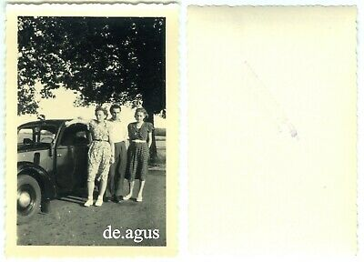 Vintage Photo circa 1960s young people with classic car