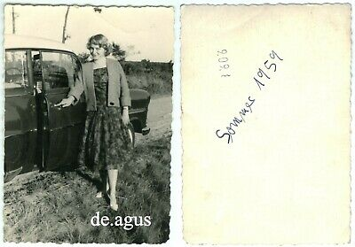 Vintage Photo circa 1959 young Woman posing with Opel Rekord classic car