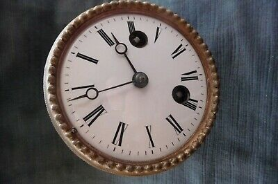 French 8day brass clock movement with enamel dial  dia 8cm