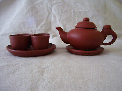 Chinese Yixing clay teapot set with four cups