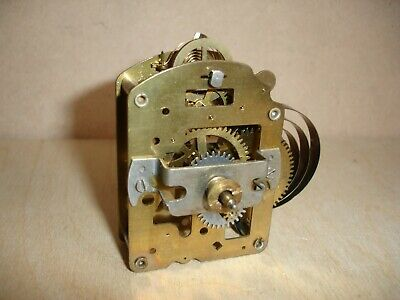 Vintage clock work mechanism does work but may need a service.