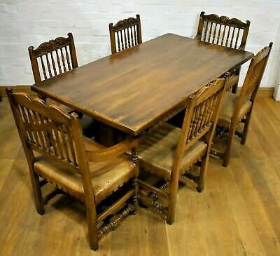 Very nice quality dining table including a set of 6 carved chairs