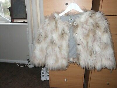 A girls fur jacket size 6 years by Next in very good used condition