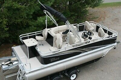 Triple tube new 1875 ft Quad Fish with 115 hp and  bunk trailer.