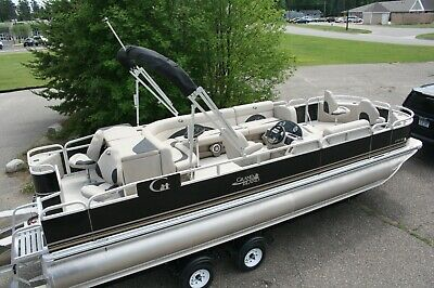 New triple tube 24 ft fish and fun 150 hp Mercury and trailer