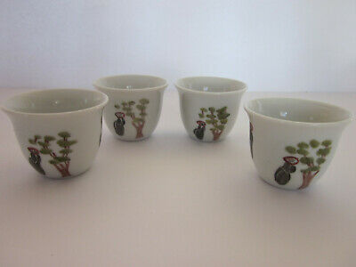 4 small china cups marked Laurette decorated trees female figures