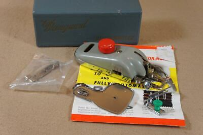Boxed Vanguard buttonholer with instructions and accessories