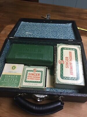 Vintage black case of Singer sewing machine attachments  221 Featherweight