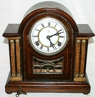 Antique 8 Day Mahogany Mantel Clock W/ Porcelain Dial & Marble Veneer Columns.