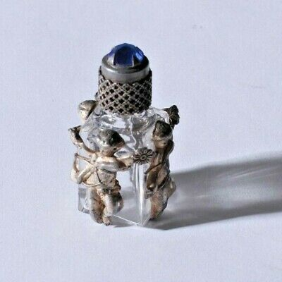Antique French 1.5 inch crystal perfume bottle with sterling cherubs, jewel top