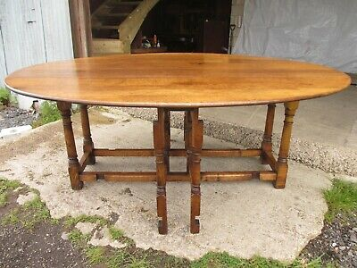 Early 20th century large golden oak wake oval drop leaf dining table (ref 753)