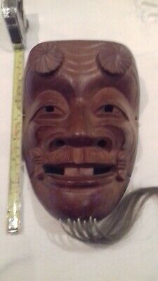 Carved wooden Japanese oni  mask