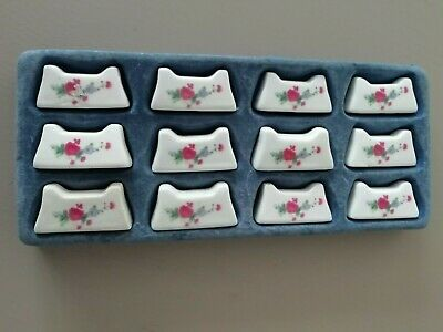Vintage Set of 12 ceramic cutlery/chopstick rests, white with delicate florals