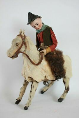 Antique FRENCH WIND UP TOY COWBOY ON HORSE BISQUE HEAD HAIR GOAT HAIR
